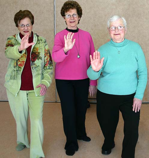 3 seniors doing Tai Chi